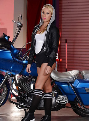 Blonde teen babe Tucker Starr poses in tight shorts at her bike