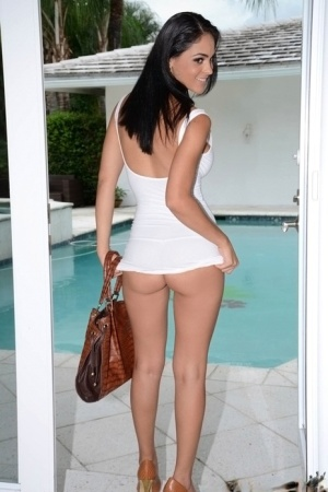 Brunette babe with big tits Jazmine shows off her ass outdoor