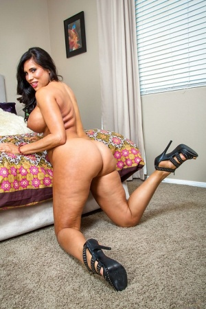 Brunette babe Sheila Marie reveals her milf ass and Latina big tits
