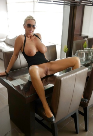 Housewife babe Sandra Otterson poses in skirt and black glasses