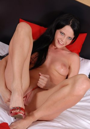 Babe brunette Aliz shows off her sextoys and awesome shaved puss