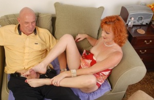 Mature Sasha is wanking this cock using her awesome long legs