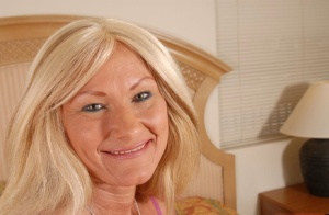 Bleached granny Roxy undresses in the bedroom and masturbates 28216498