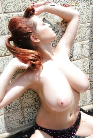 Redhead Tessa Fowler is showing up her amazing big natural tits