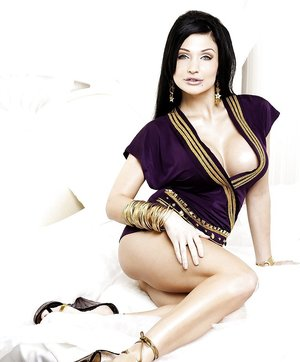 Busty pornstar Aletta Ocean poses in amazing dress with naked tits