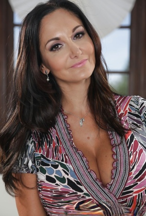 Big-tit milf Ava Addams shows off her awesome tanned boobies