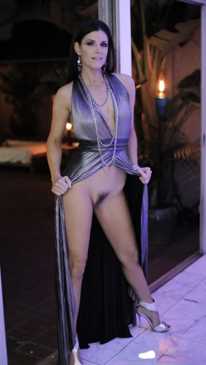 Mature brunette India Summer shows what lives beneath her long dress