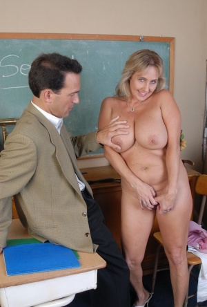 Mature teacher Wanda strips off her clothes in the classroom