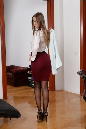 Euro office worker Suzie Moss takes off her glasses and business suit 41010102