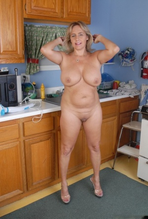 Chubby older woman Wanda strips and plays with kitchen utensils 50967749