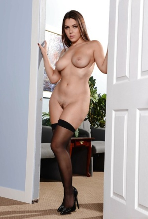 Busty maid Valentina Nappi exposing large tits in nylons and high heels 39127902
