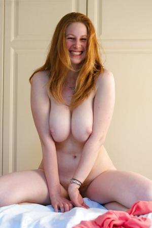 Busty redhead Chloe B plays with large natural tits and licks own nipple