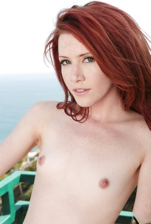 Petite redhead model Elle Alexandra poses outdoors in bikini top and shorts