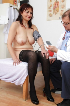 Older woman Remy strips down to underwear and stockings in doctors office 46770125