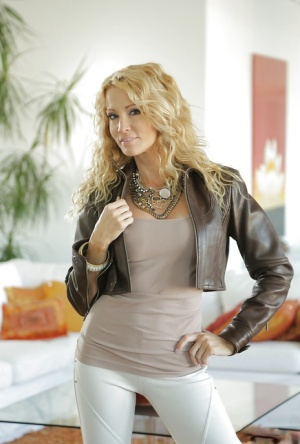 Blonde babe Jessica Drake posing fully clothed in yoga pants and leather 71200453