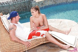 Thin blonde chick Susan giving a blowjob outside beside swimming pool