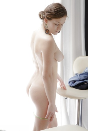 Pretty 18 year old girl Parvin stripping naked for porn modelling debut