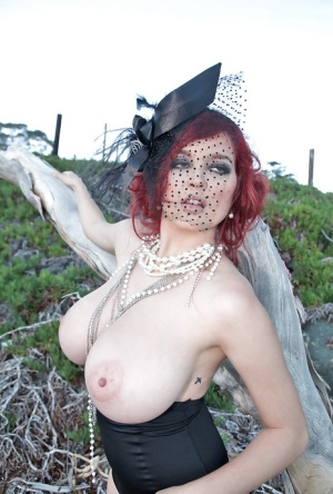 Big boob babe Tessa Fowler posing in vintage style hat while flashing tits