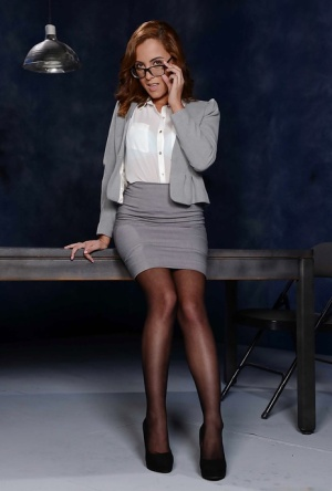 Short babe in glasses and skirt Roxanne Rae flashing leg and nylons