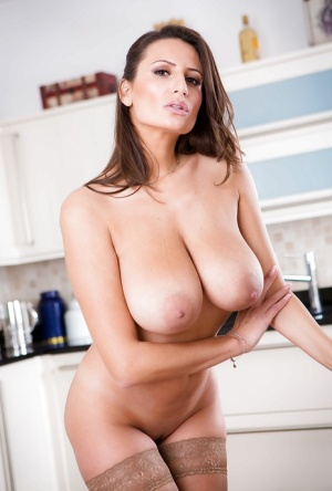 Leggy mommy Sensual Jane modeling in pantyhose and thong in kitchen