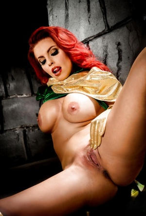 Busty redhead Britney Amber modeling topless in cosplay outfit