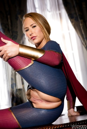 Leggy blonde pornstar Carter Cruise opens crotchless outfit to expose cunt