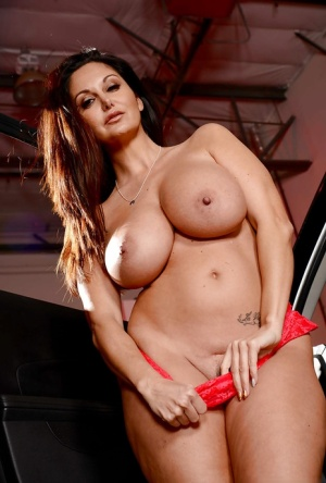 Top heavy policewoman Ava Addams strips naked for pussy spreading