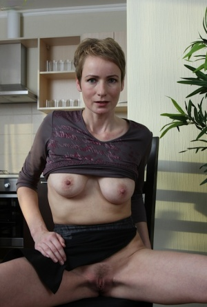 Tall short haired older broad Sweet Nensy revealing mature breasts