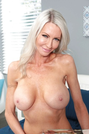 Older MILF Emma Starr modelling solo girl style in bra and panties