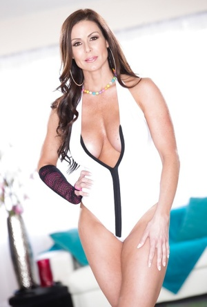 Buxom MILF Kendra Lust flaunting her big breasts and long legs