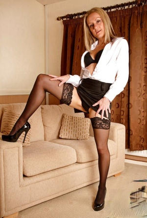 Older blonde doll Emma Starr modeling fully clothed in skirt and nylons