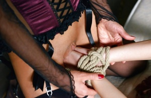 Bound redhead Susana Melo dominated by lingerie clad dyke Dominica Phoenix