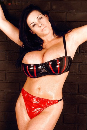 Linsey Dawn McKenzie has her oiled up boobs barely covered by latex lingerie