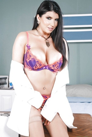 Brunette solo girl Romi Rain letting nice melons free from nurse uniform