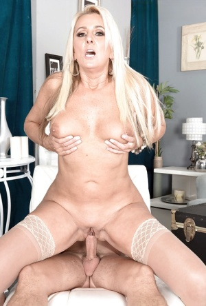 Blonde cougar Dallas Matthews seduces younger man with big tits in nylons
