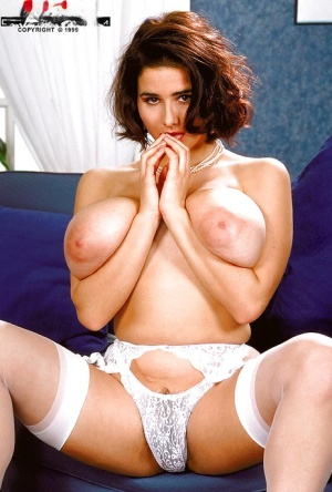 French MILF Chloe Vevrier exposes huge natural tits for self nipple licking
