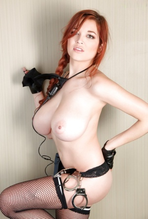 Redhead babe Tessa Fowler flaunting big natural tits in police uniform
