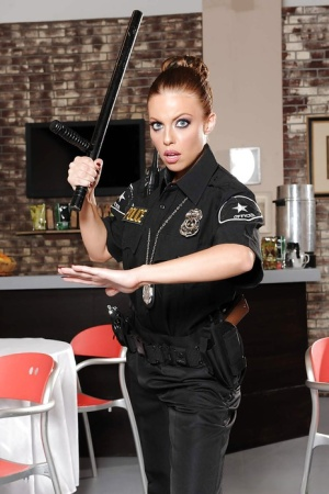 Solo girl Britney Amber frees big pornstar boobs from police unifrom
