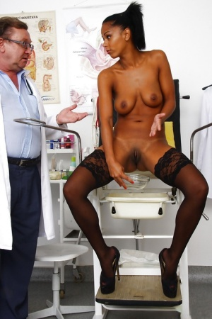 Leggy Latina chick in stockings spreads shaved pussy for Gyno doctor