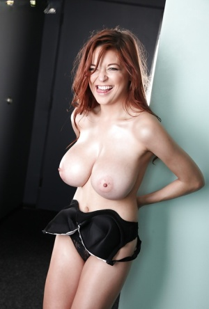 Redheaded solo girl Tessa Fowler freeing nice melons from lingerie