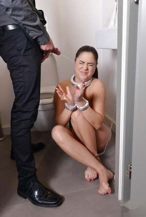 Collared sex slave Nikki Waine gets pissed on in bathroom after giving bj