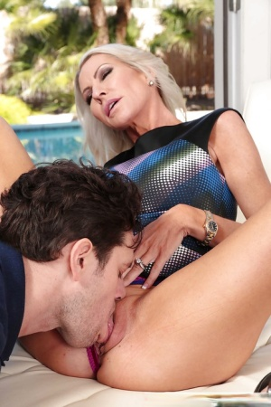 Busty amateur blonde MILF Emma Starr engages in hardcore sex by pool