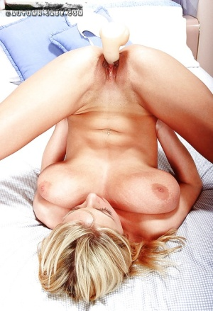 Blonde babe Autumn Jade fondling huge pornstar tits while toying pussy