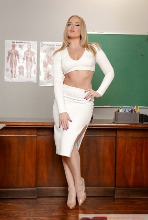 Solo girl Alexis Texas revealing phat MILF ass on teachers desk