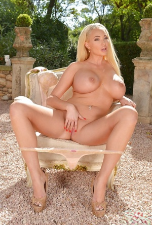 Blonde babe Summer Brielle freeing large tits from lingerie outdoors