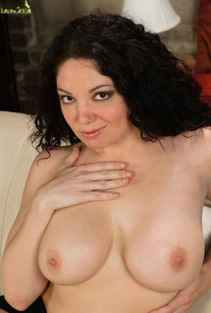 Brunette MILF Kiki Daire sheds lingerie to expose big natural tits and ass