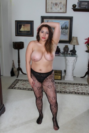 Mature Italian BBW CeCe Giovanni baring huge juggs and shedding pantyhose