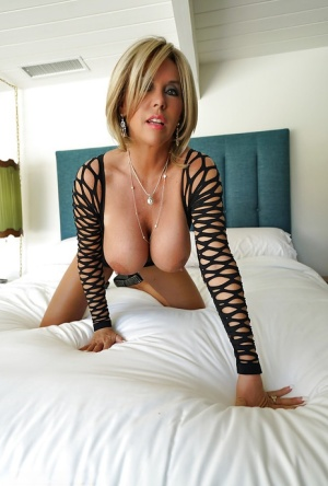 Buxom housewife Sandra Otterson showing off great legs during babe spread