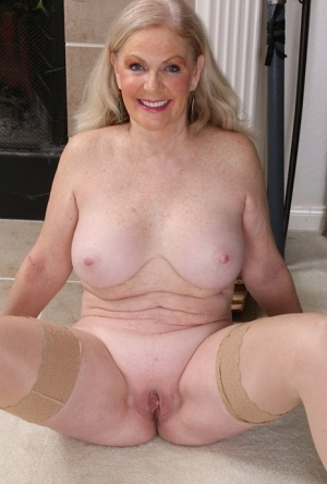 Stocking garbed aged blonde Judy Belkins spreading shaved cunt in stockings