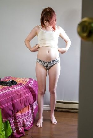 Amateur redhead babe pulling panties and shorts over bare ass 72754747